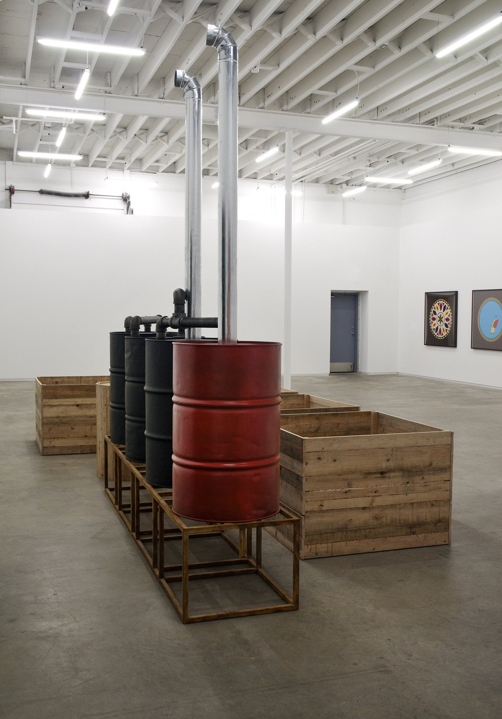 Myfanwy MacLeod, Everything Seems Empty Without You, 2009, metal oil drums, metal sand, metal pipes, wooden boxes, wooden barrel, 118 x 332 x 94 in. (300 x 843 x 239 cm) by Myfanwy MacLeod