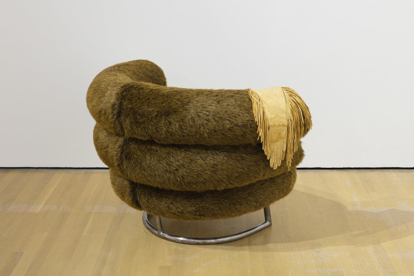 Liz Magor, Banff Chair, 1991, steel base, soft polyurethane foam, synthetic fur, deerskin gloves, 30 x 35 x 44 in. (77 x 88 x 111 cm). Installation view, Habitude, Musée d'art contemporain de Montréal, 2016 by Liz Magor