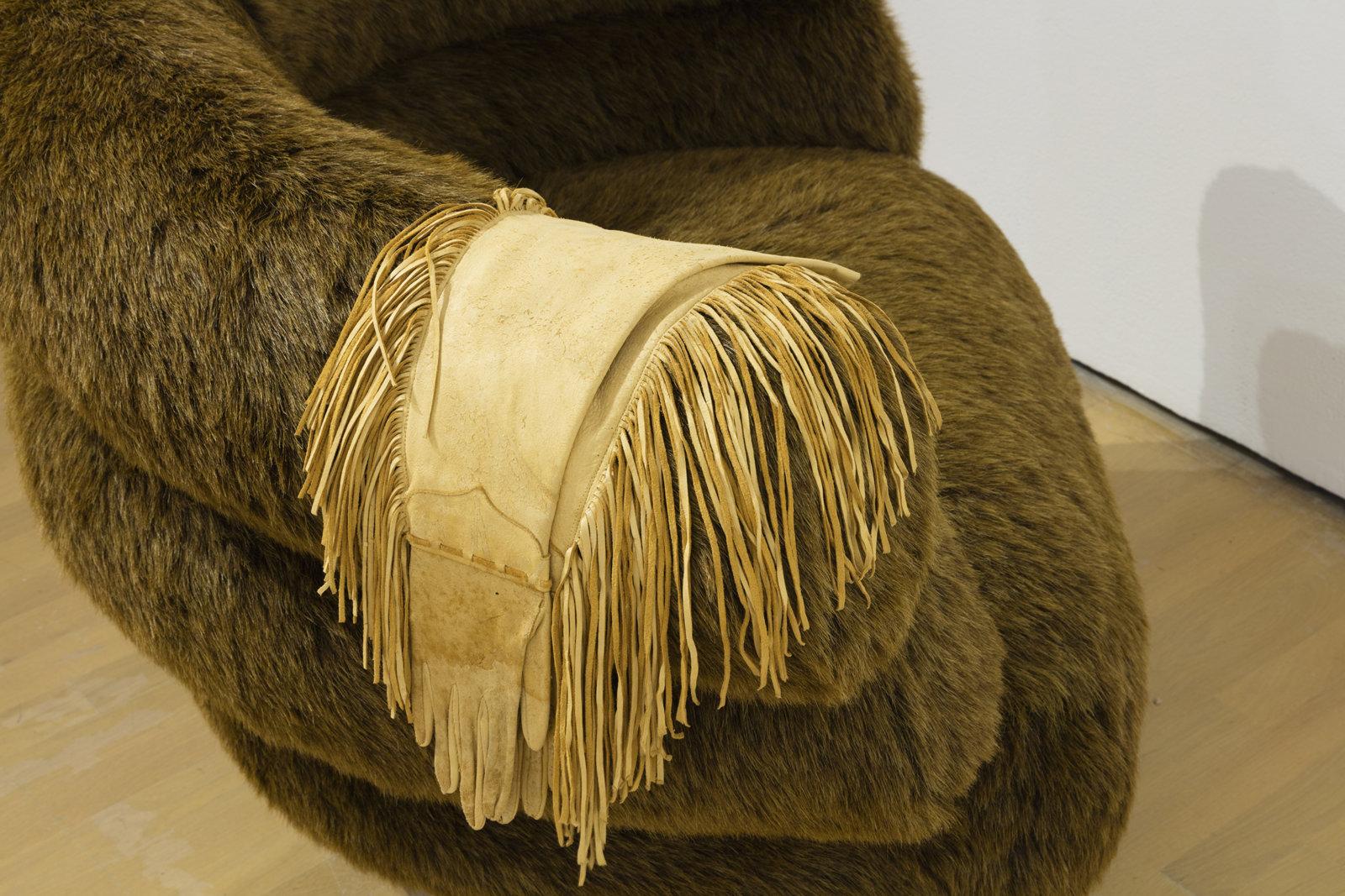 Liz Magor, Banff Chair (detail), 1991, steel base, soft polyurethane foam, synthetic fur, deerskin gloves, 30 x 35 x 44 in. (77 x 88 x 111 cm). Installation view, Habitude, Musée d'art contemporain de Montréal, 2016 by Liz Magor