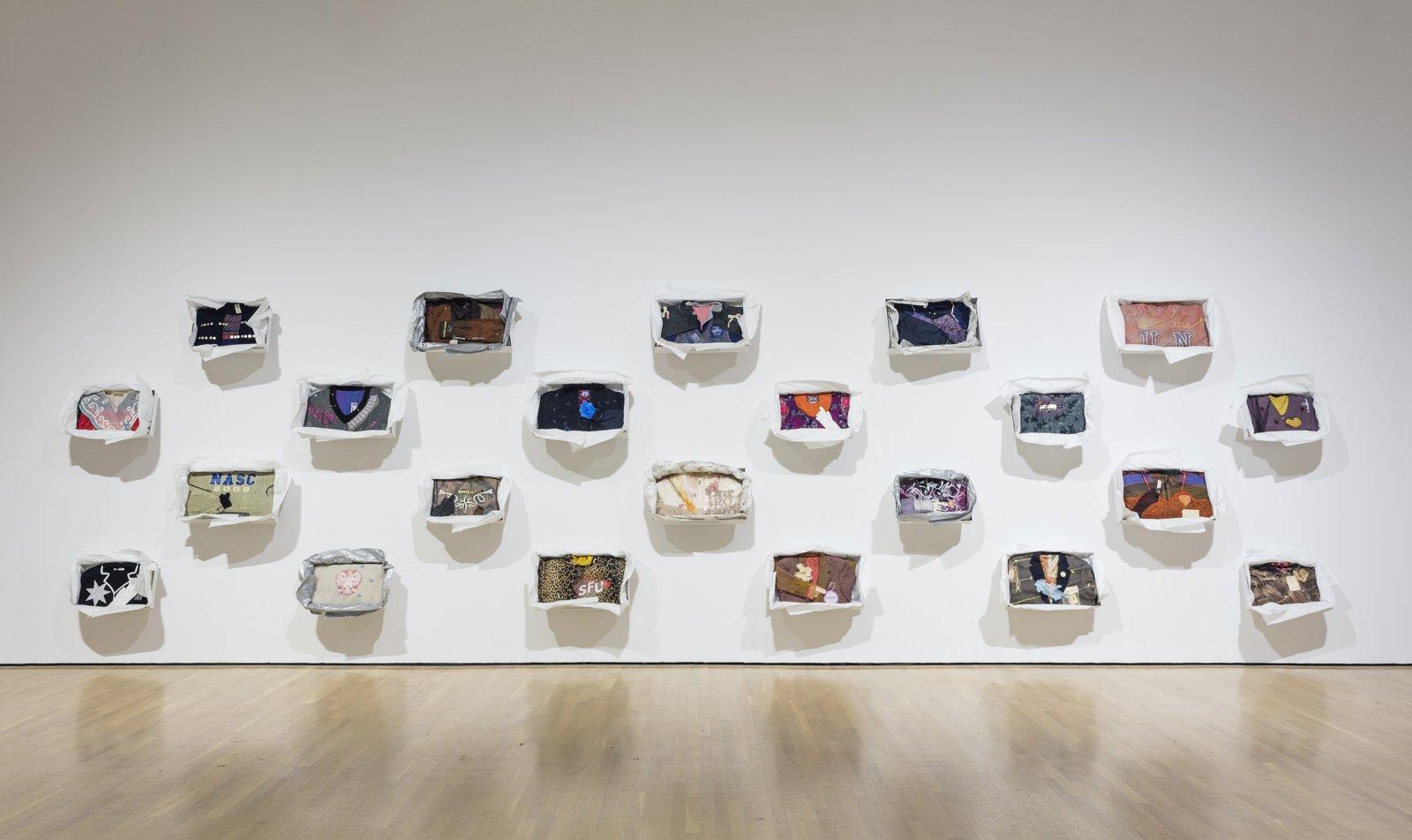 Liz Magor, Being This, 2012, 24 boxes, paper, textiles, found materials, each approximately 12 x 19 x 3 in. (31 x 48 x 6 cm). Installation view, Habitude, Musée d'art contemporain de Montréal, 2016 by Liz Magor