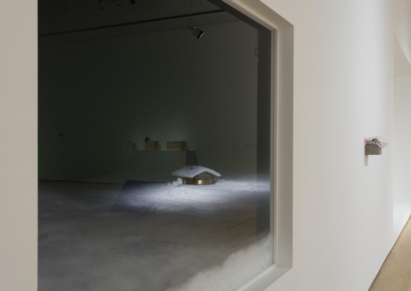 Liz Magor, Cabin in the Snow, 1989, fabric, model log cabin, dimensions variable. Installation view, Habitude, Musée d'art contemporain de Montréal, 2016 by Liz Magor
