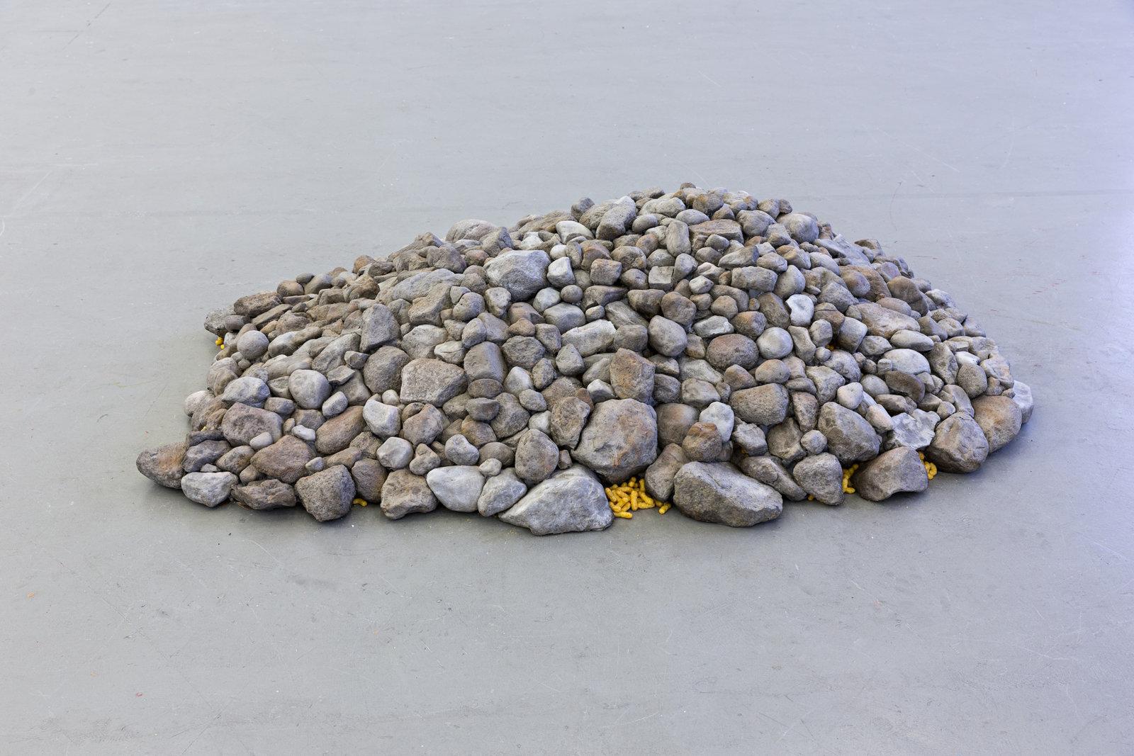 Liz Magor, Chee-to, 2000, polymerized gypsum, cheesies, 17 x 66 x 79 in. (42 x 168 x 200 cm) by Liz Magor