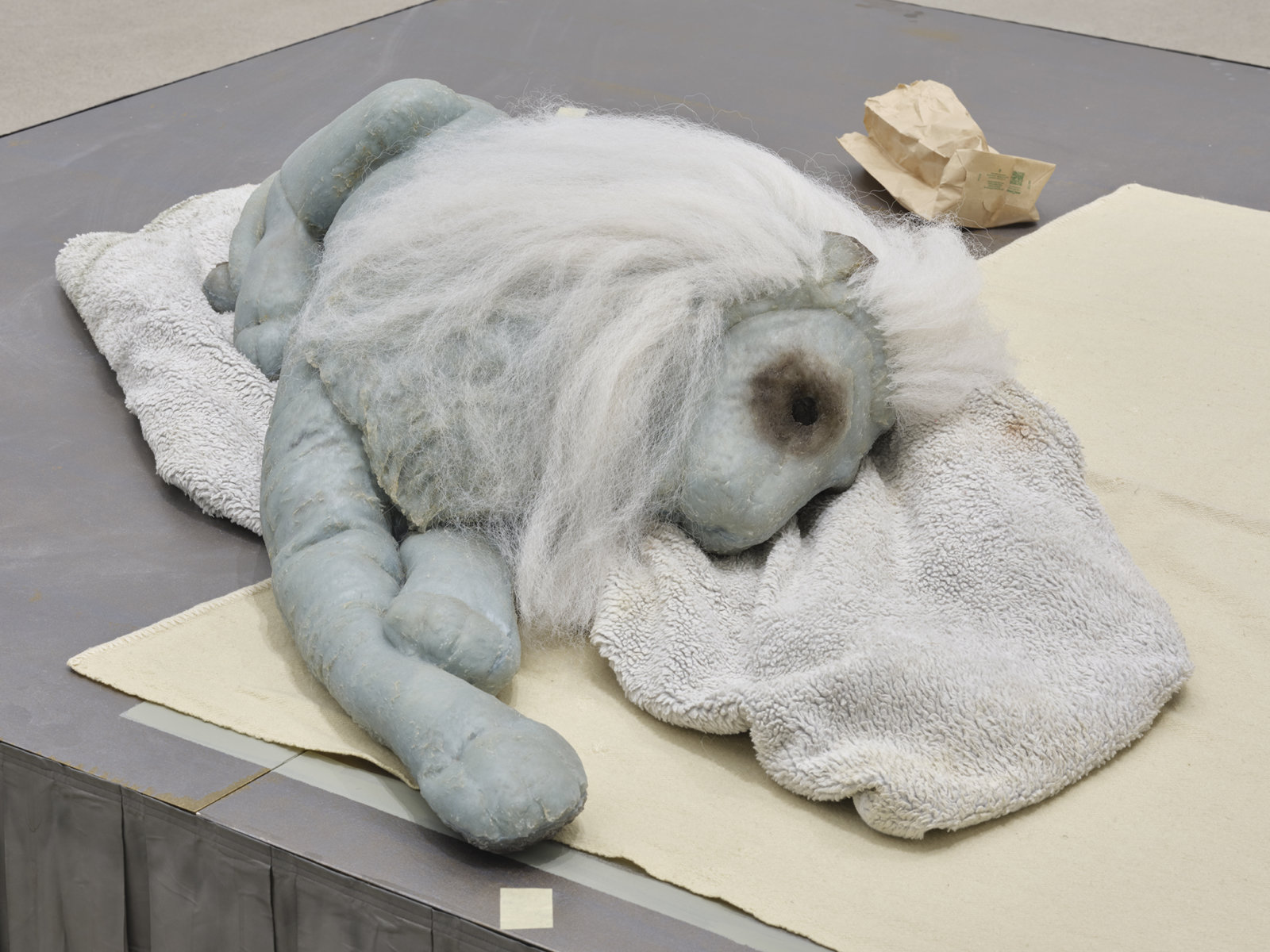 Liz Magor, Coiffed (detail), 2020, painted plywood, fabric skirting, silicone rubber, artificial hair, acrylic throw, woollen blankets, silver fabric, linen, jewellery boxes, costume jewellery, packaging materials, 27 x 132 x 96 in. (69 x 335 x 244 cm) by Liz Magor