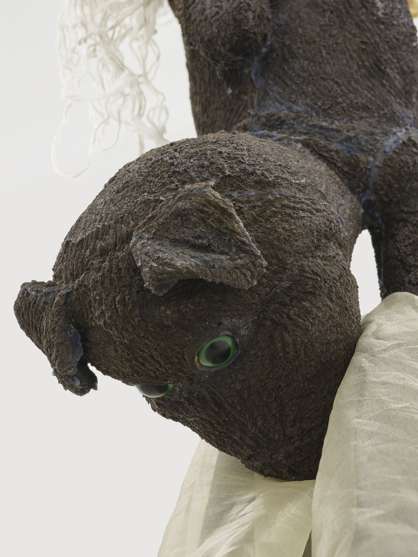 Liz Magor, Delivery (brown), 2018, silicone rubber, textiles, twine, 191 x 42 x 42 in. (485 x 107 x 107 cm) by Liz Magor