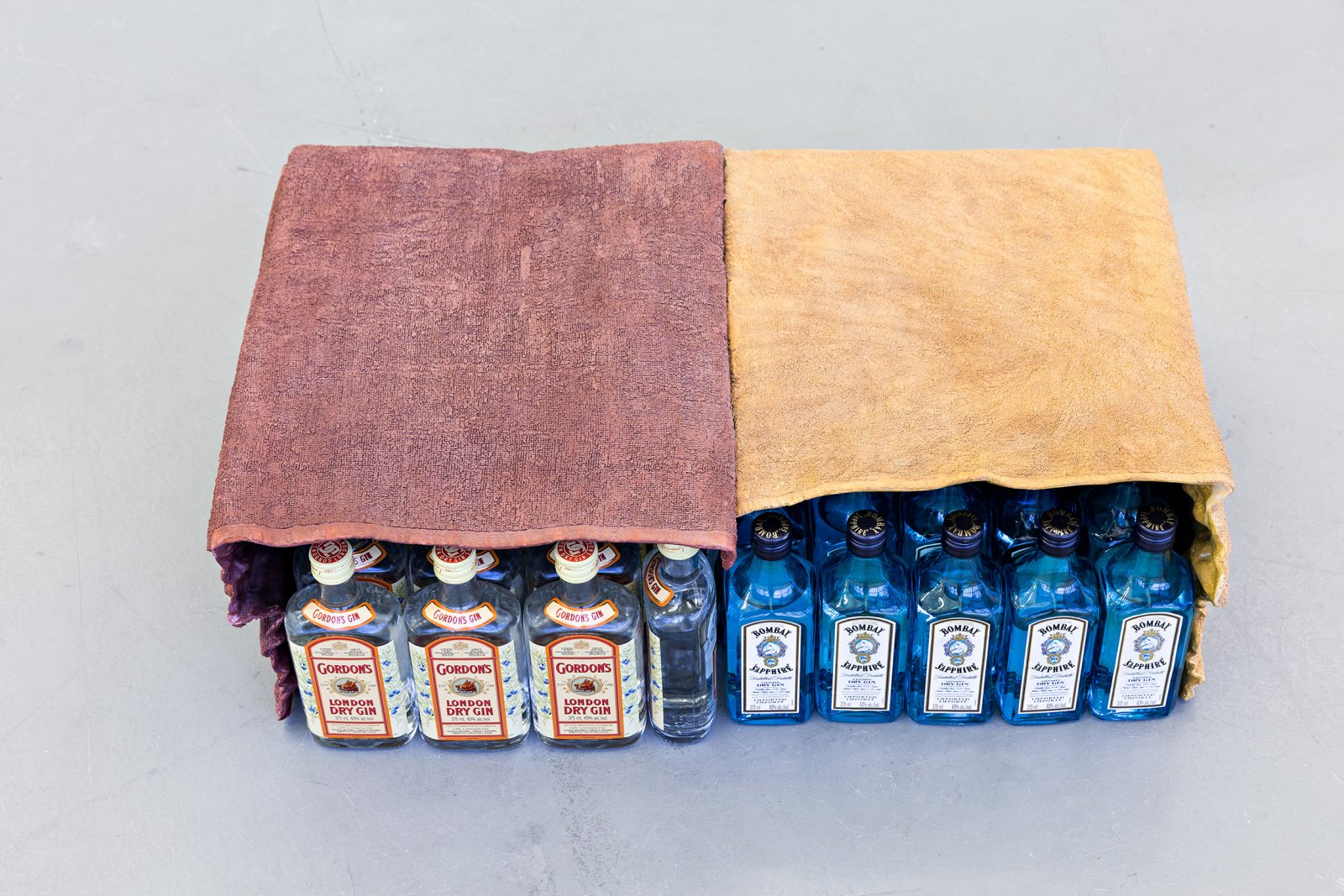 Liz Magor, Double Cabinet (Rust and Wine), 2001, polymerized gypsum, bottles of gin, 9 x 27 x 17 in. (24 x 69 x 43 cm) by Liz Magor