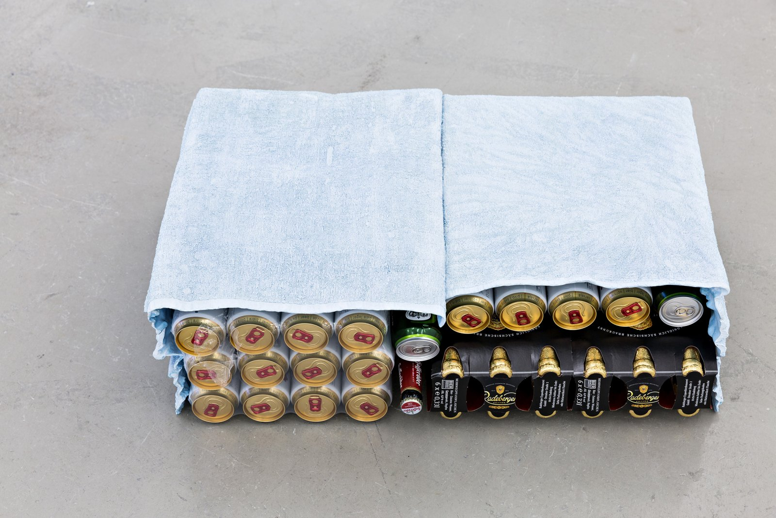 Liz Magor, Double Cabinet (blue), 2001, polymerized gypsum, cans of beer, 9 x 27 x 17 in. (24 x 69 x 43 cm) by Liz Magor