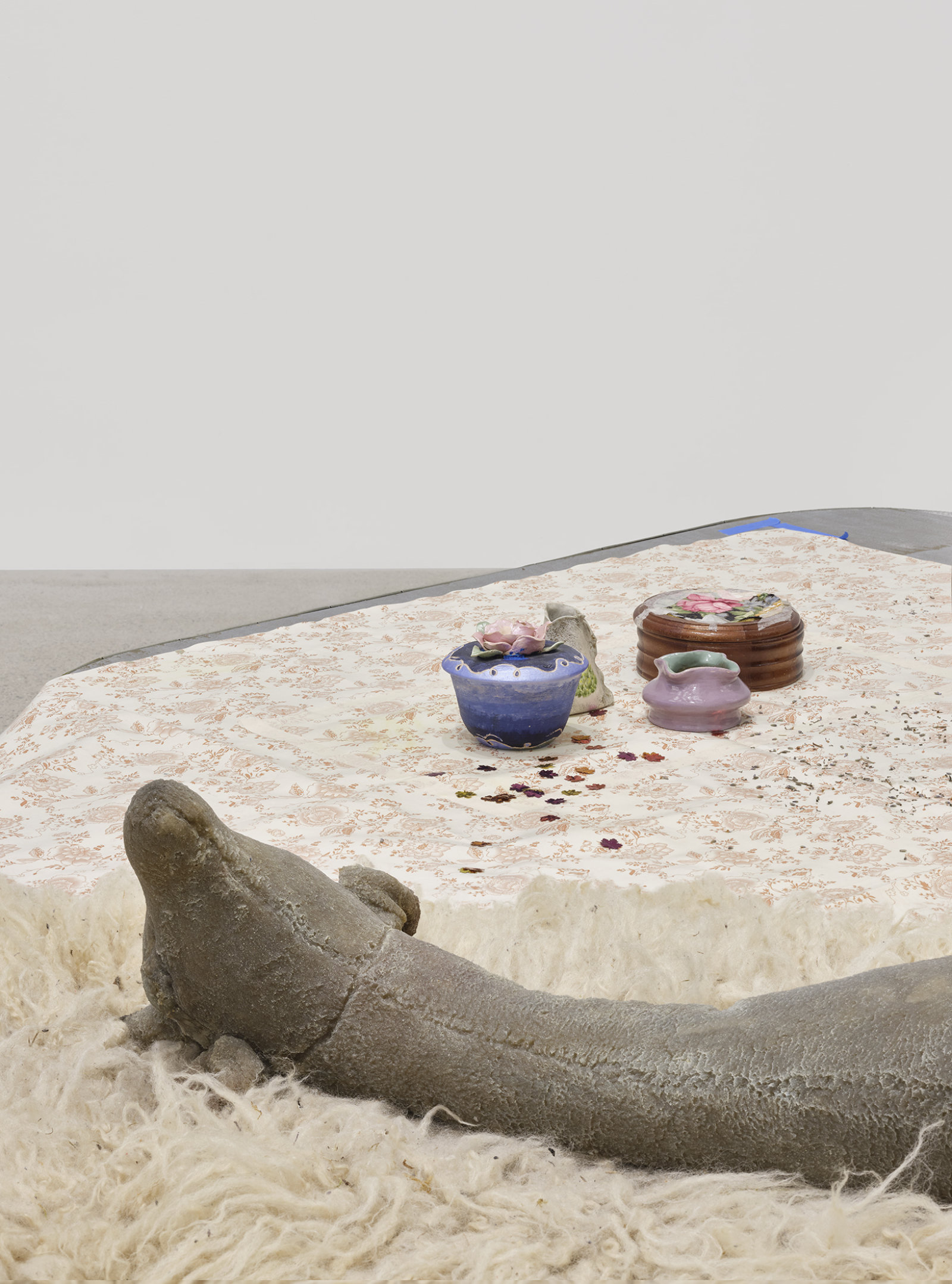 Liz Magor, Dressed (detail), 2020, painted plywood, fabric skirting, silicone rubber, hosiery, sheepskin, vinyl tablecloth, wood and ceramic crafts, plastic cup, dried lavender, packaging materials, 28 x 120 x 108 in. (71 x 305 x 274 cm) by Liz Magor