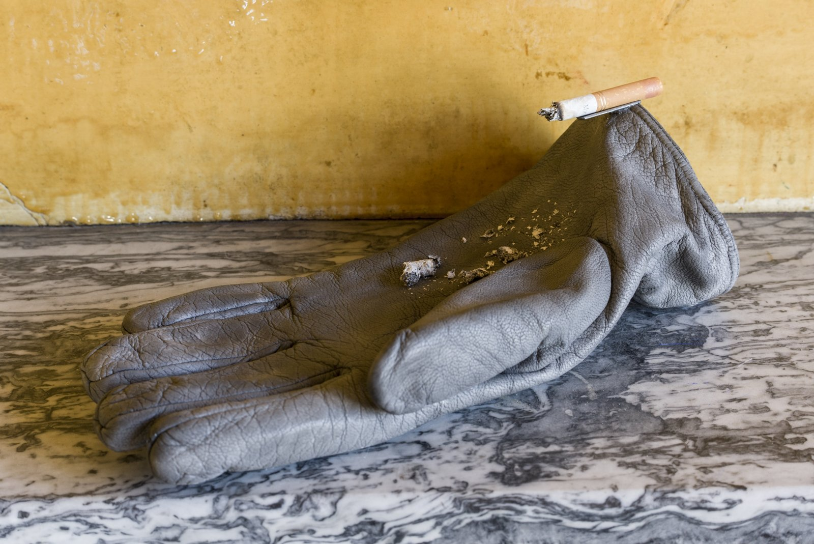 Liz Magor, Leather Palm, 2019, polymerized gypsum, cigarette, metal, 11 x 6 x 4 in. (28 x 15 x 10 cm). Installation view, TIMESHARE, The David Ireland House, 500 Capp Street Foundation, San Francisco, USA, 2019 by Liz Magor