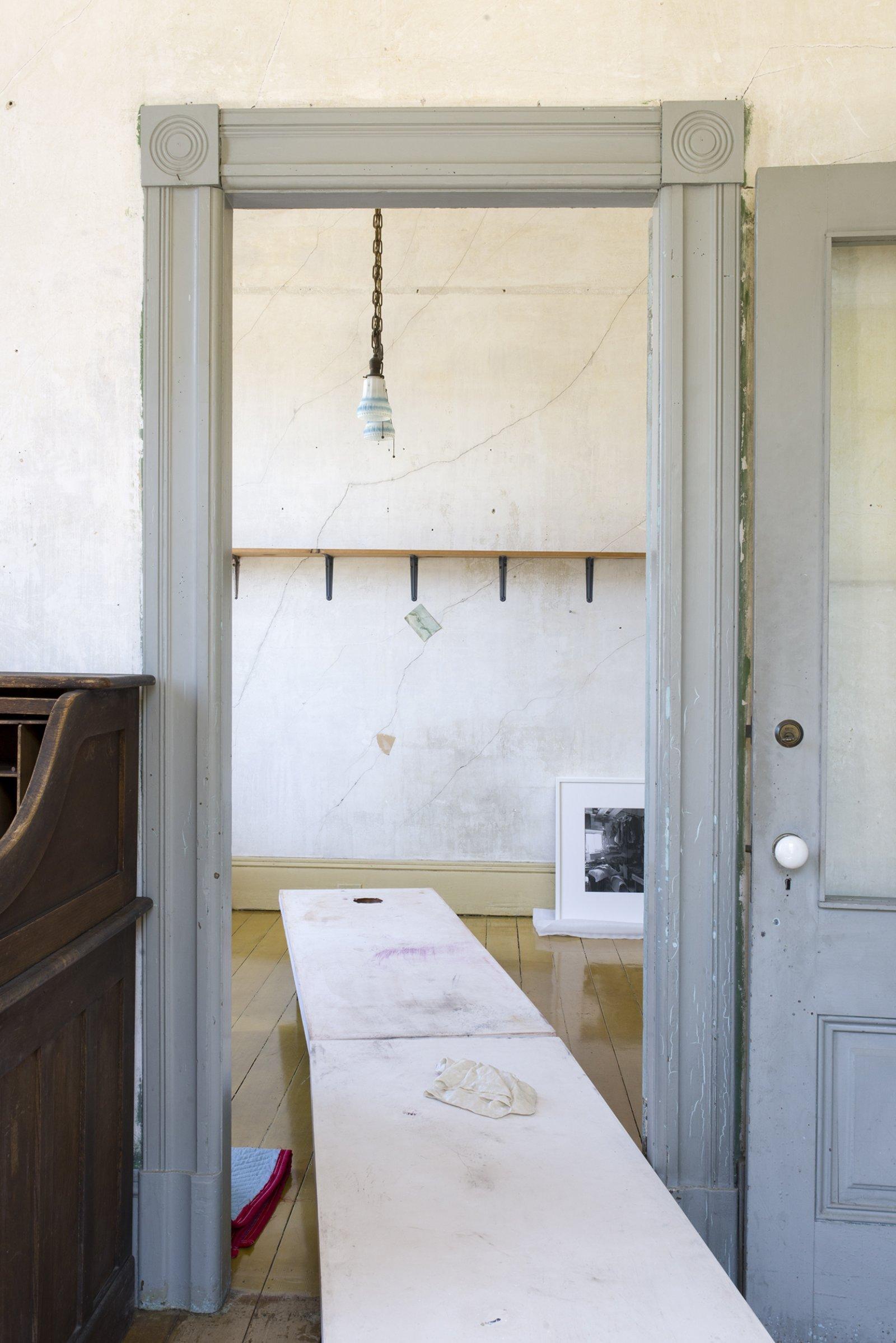 Liz Magor, Long Table (ashtray), 2006–2018, polymerized gypsum, 22 x 24 x 78 in. (56 x 61 x 198 cm). Installation view, TIMESHARE, The David Ireland House, 500 Capp Street Foundation, San Francisco, USA, 2019 by Liz Magor