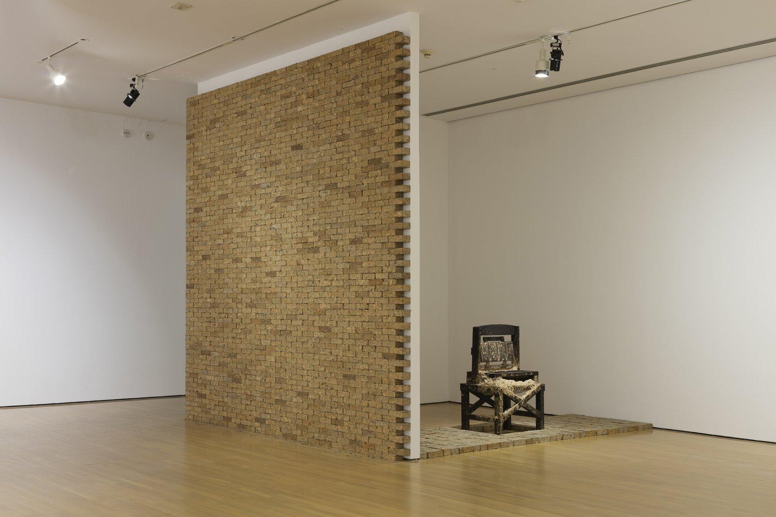 Liz Magor, Production, 1980, newspaper, wood, steel, approximately 2800 paper bricks, each 2 x 4 x 8 in. (5 x 10 x 20 cm), machine: 53 x 32 x 24 in. (135 x 81 x 61 cm) by Liz Magor