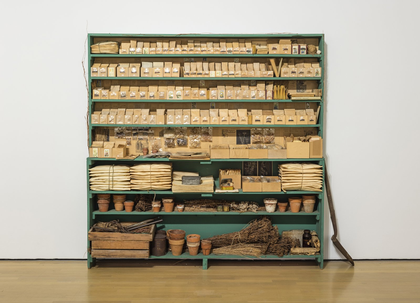 Liz Magor, Sowing Weeds in Lanes and Ditches, 1976,  wooden shelf, seeds, grass, envelopes, boxes, garden gloves, clay pots, 77 x 77 x 11 in. (196 x 196 x 27 cm) by Liz Magor