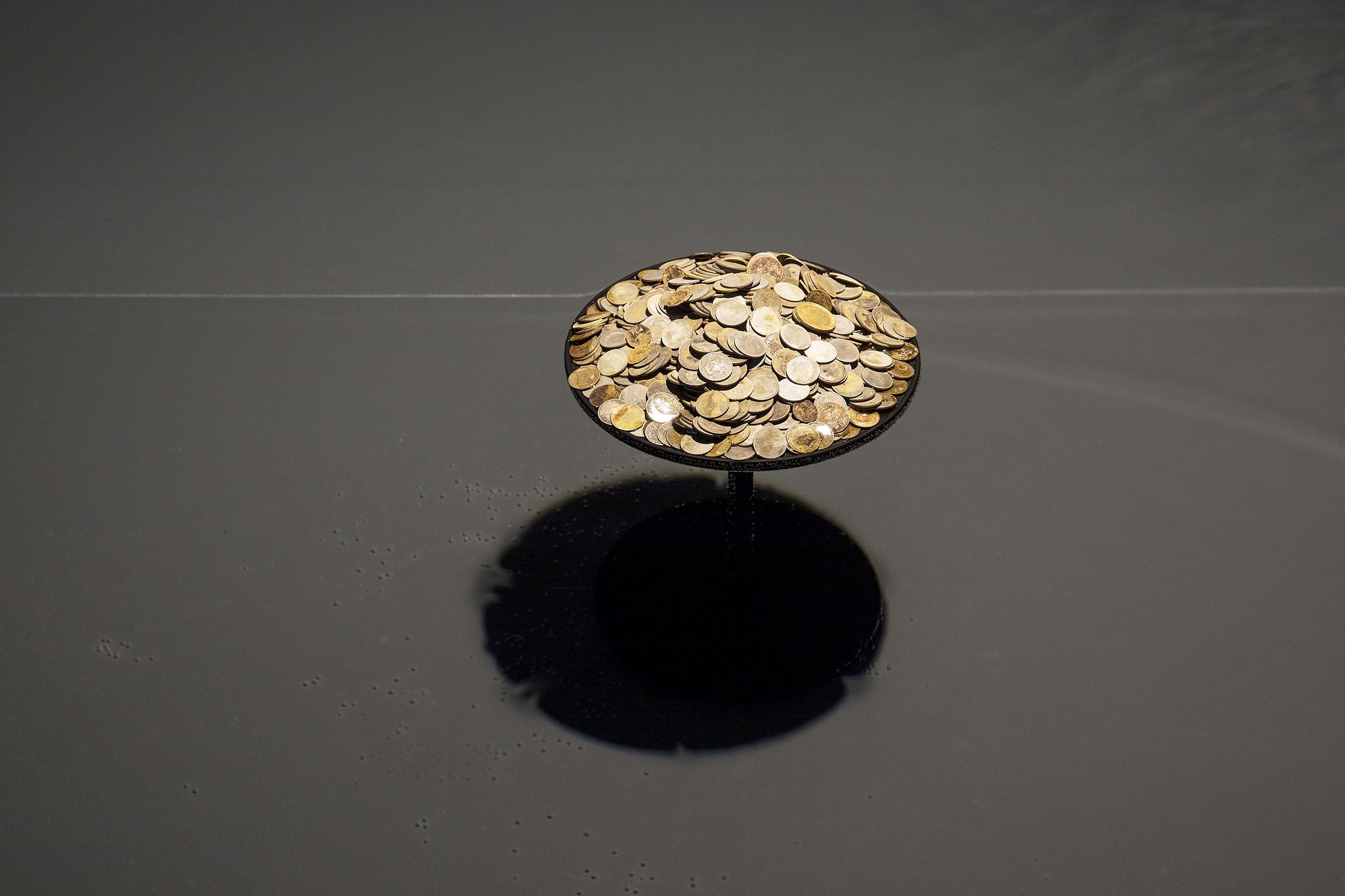 Gareth Moore, Thai Bank (Omsin), 600 Thai coins removed from the stomach of a sea turtle, 10 x 10 x 14 in. (25 x 25 x 36 cm). Installation view, A Dark Switch Yawning..., Salzburger Kunstverein, Salzburg, 2017 by