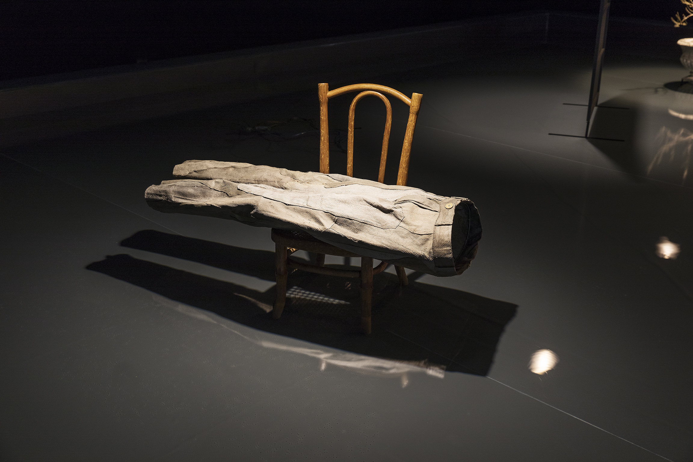 Gareth Moore, Into the Water (In his Leather Breeches), 2008, fish leather, cotton thread, maple buttons, wooden chair, 28 x 35 x 15 in. (71 x 89 x 38 cm). Installation view, A Dark Switch Yawning..., Salzburger Kunstverein, Salzburg, 2017 by