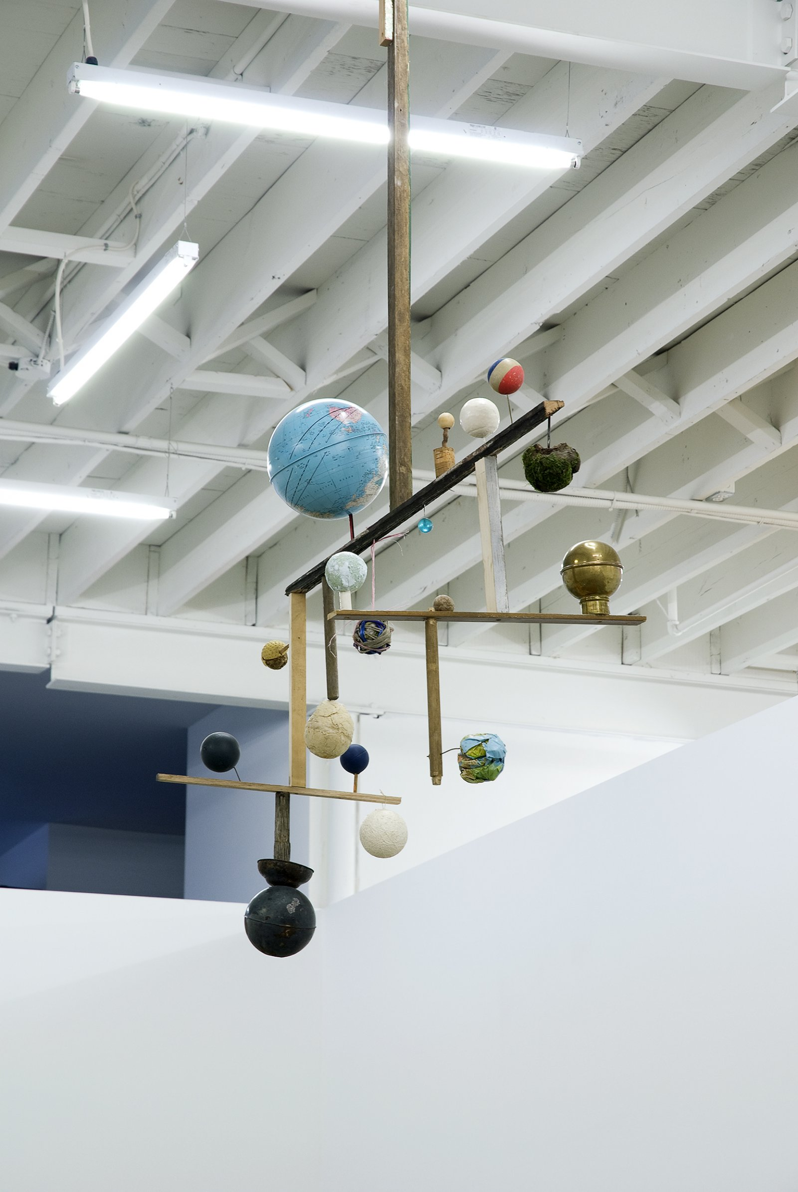 Gareth Moore, Crown Compass from Uncertain Pilgrimage, 2009, globes, balls, paint, scrap material, 103 x 22 x 54 in. (262 x 57 x 137 cm)   by Gareth Moore
