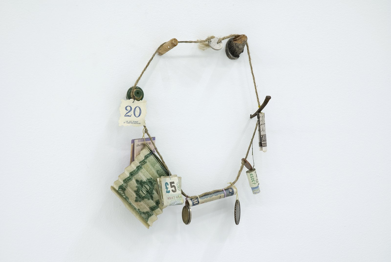 Gareth Moore, Necklace from Uncertain Pilgrimage, 2006-2009, string, thread, found wood, nail, various past and present currencies, 9  x 8 x 2 in. (24 x 20 x 6 cm) by Ashes Withyman