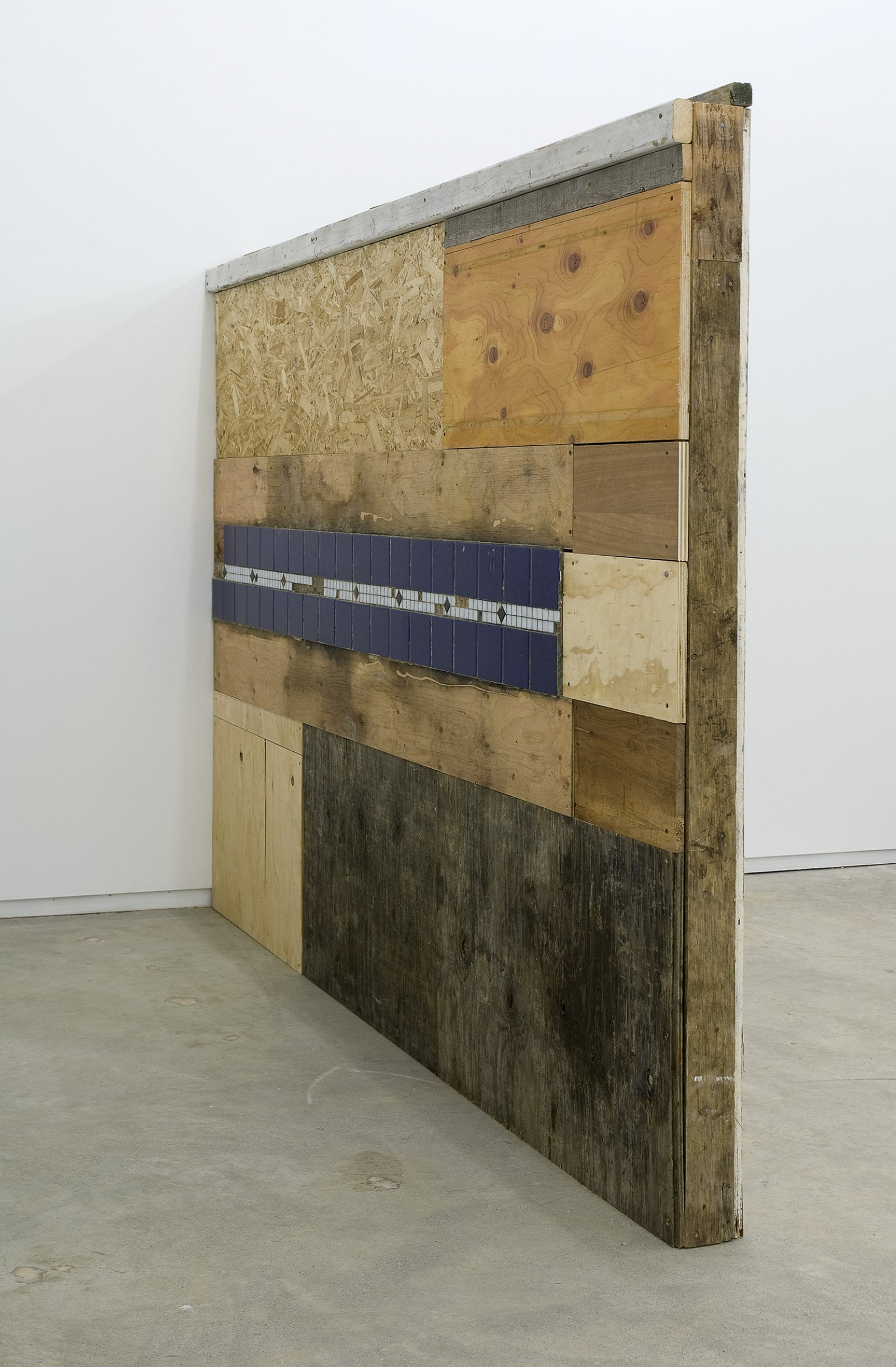 Gareth Moore, Piss Wall from Uncertain Pilgrimage, 2009, found wood, tile, 73 x 100 x 5 in. (186 x 253 x 13 cm)   by Gareth Moore