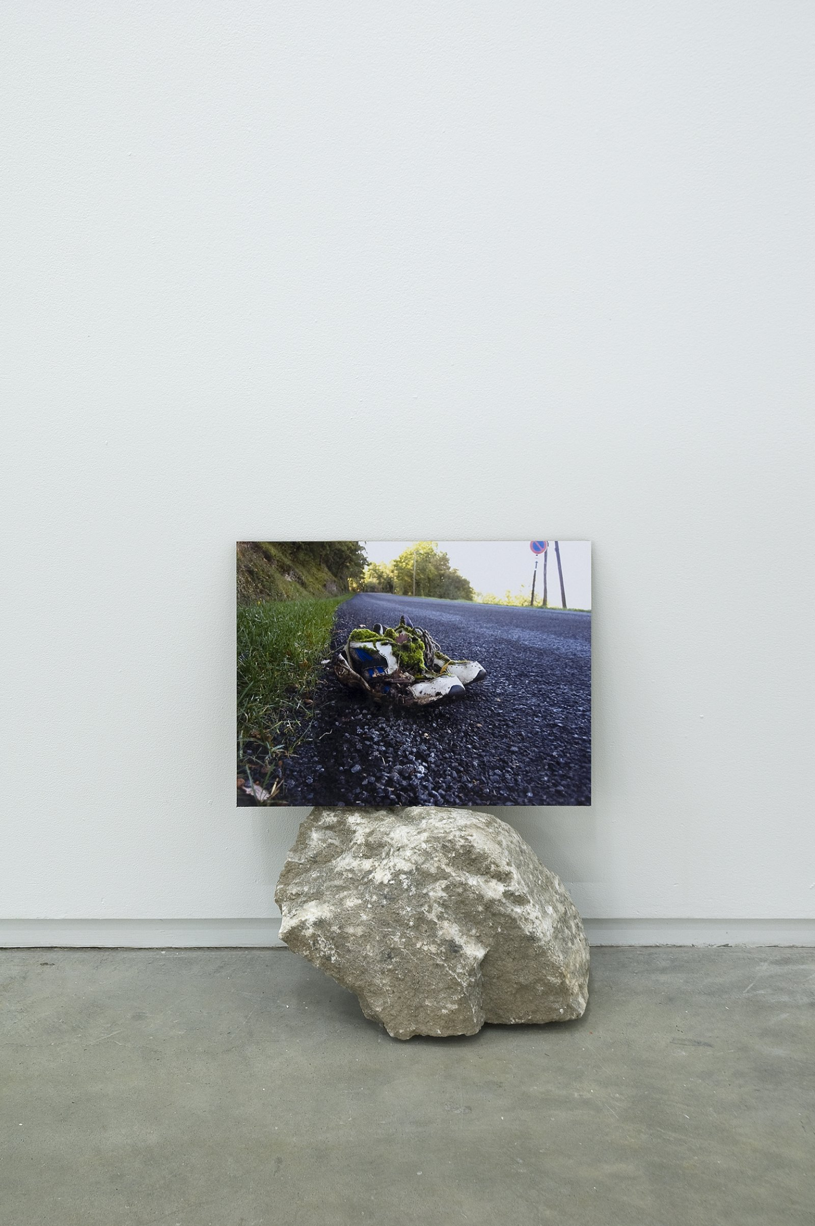 Gareth Moore, Tarring Wheels from Uncertain Pilgrimage, 2006-2009, lightjet print, cardboard, rock, 21 x 16 x 8 in. (53 x 41 x 19 cm) by Ashes Withyman