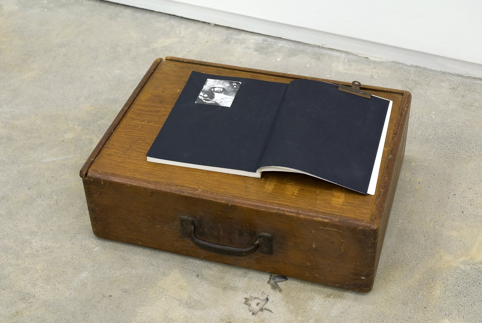 Gareth Moore, The brush has almost dropped from his hands from Uncertain Pilgrimage, 2006-2009, book, black paper, wooden case, 6 x 20 x 6  in. (15 x 51 x 16 cm) by Ashes Withyman