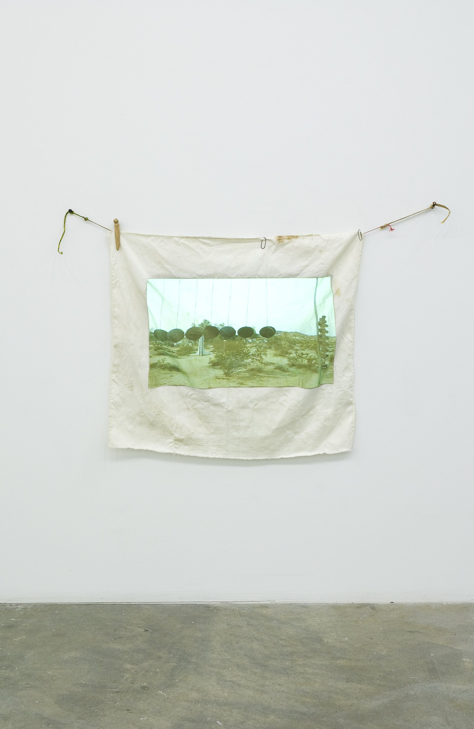 Gareth Moore, Travel Without Movement from Uncertain Pilgrimage, 2006–2007, dvd projection, cloth projection screen, clothespins, paperclips, string, 32 x 41 in. (80 x 105 cm), 12 minutes, 10 seconds by Gareth Moore