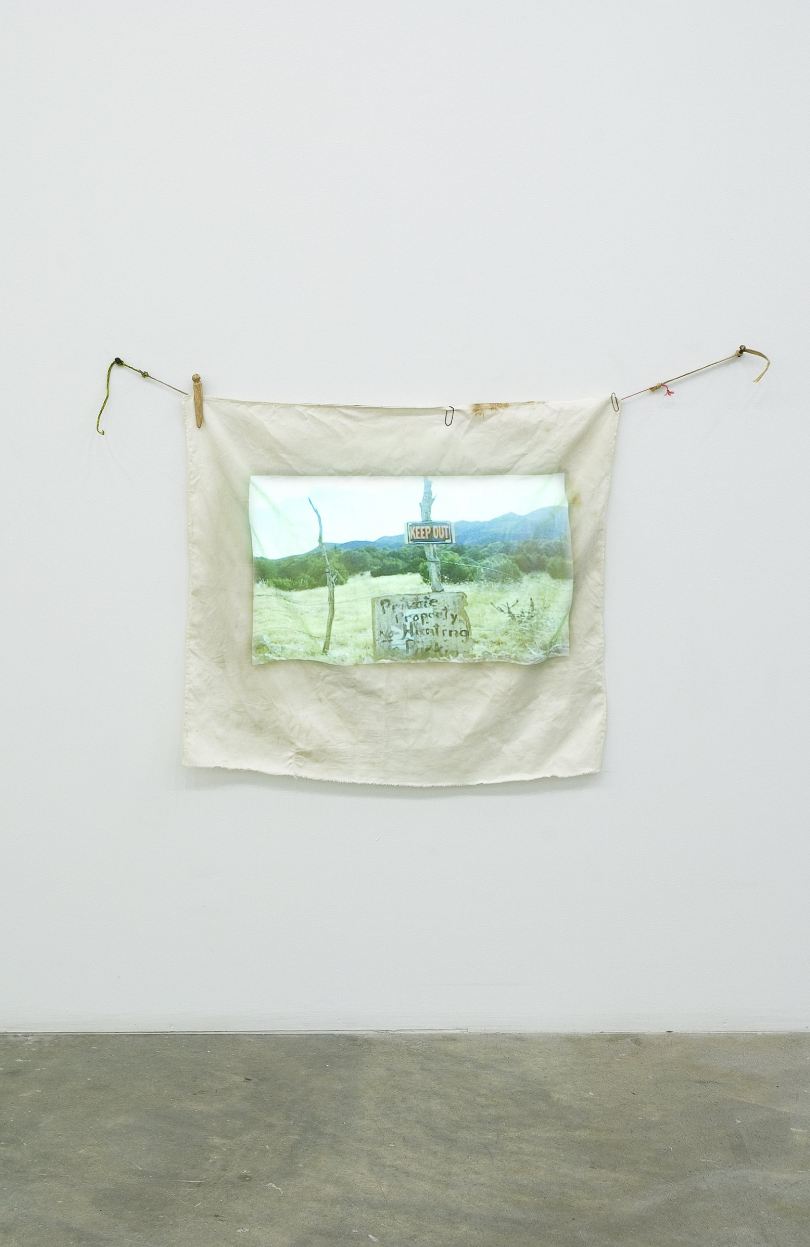 Gareth Moore, Travel Without Movement from Uncertain Pilgrimage, 2006–2007, dvd projection, cloth projection screen, clothespins, paperclips, string, 32 x 41 in. (80 x 105 cm), 12 minutes, 10 seconds by Ashes Withyman