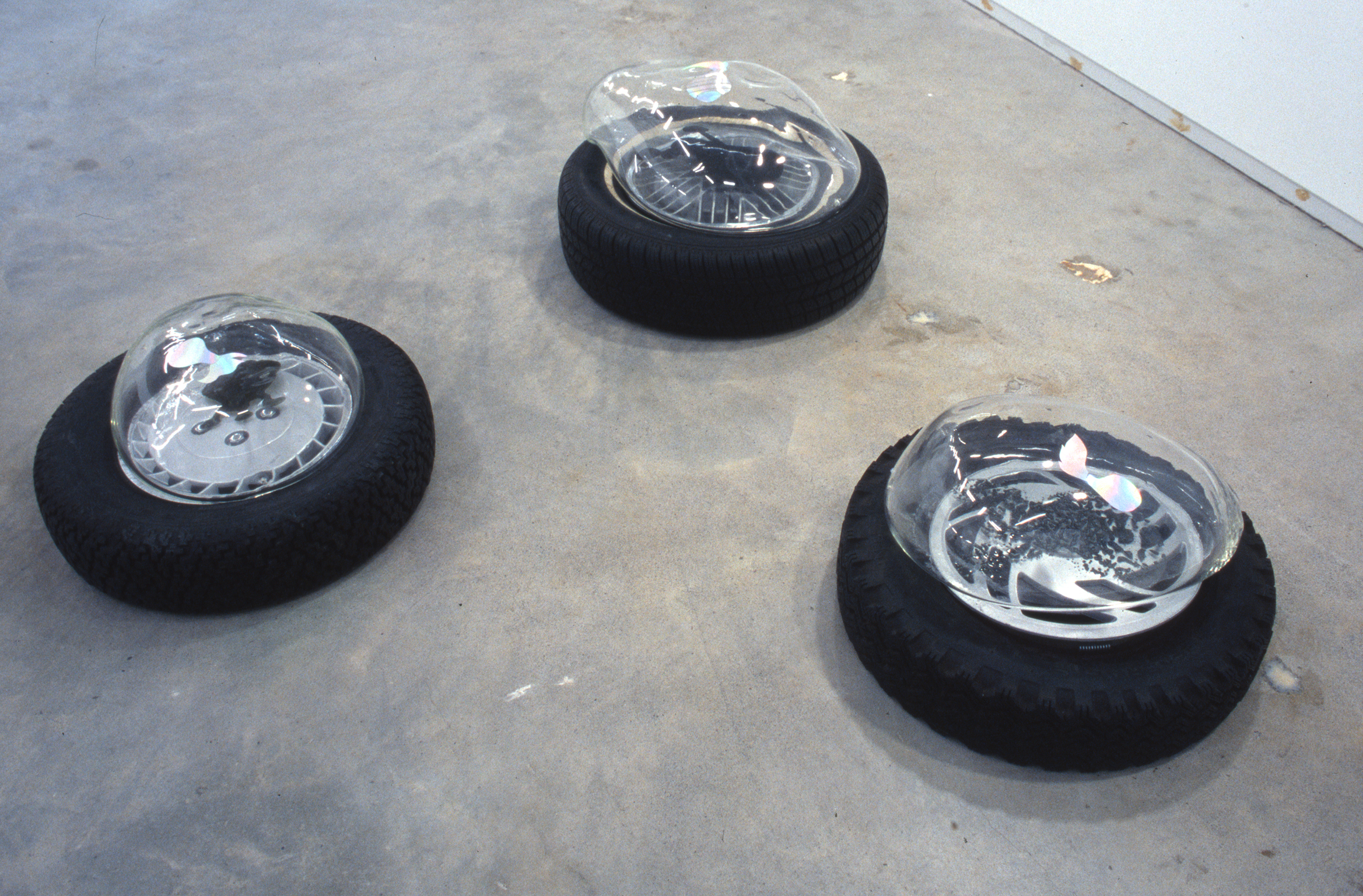 Jerry Pethick, Aerial View, 2001–2002, tires, spectrafoil cut-outs, black silicone, blown glass, dimensions variable by