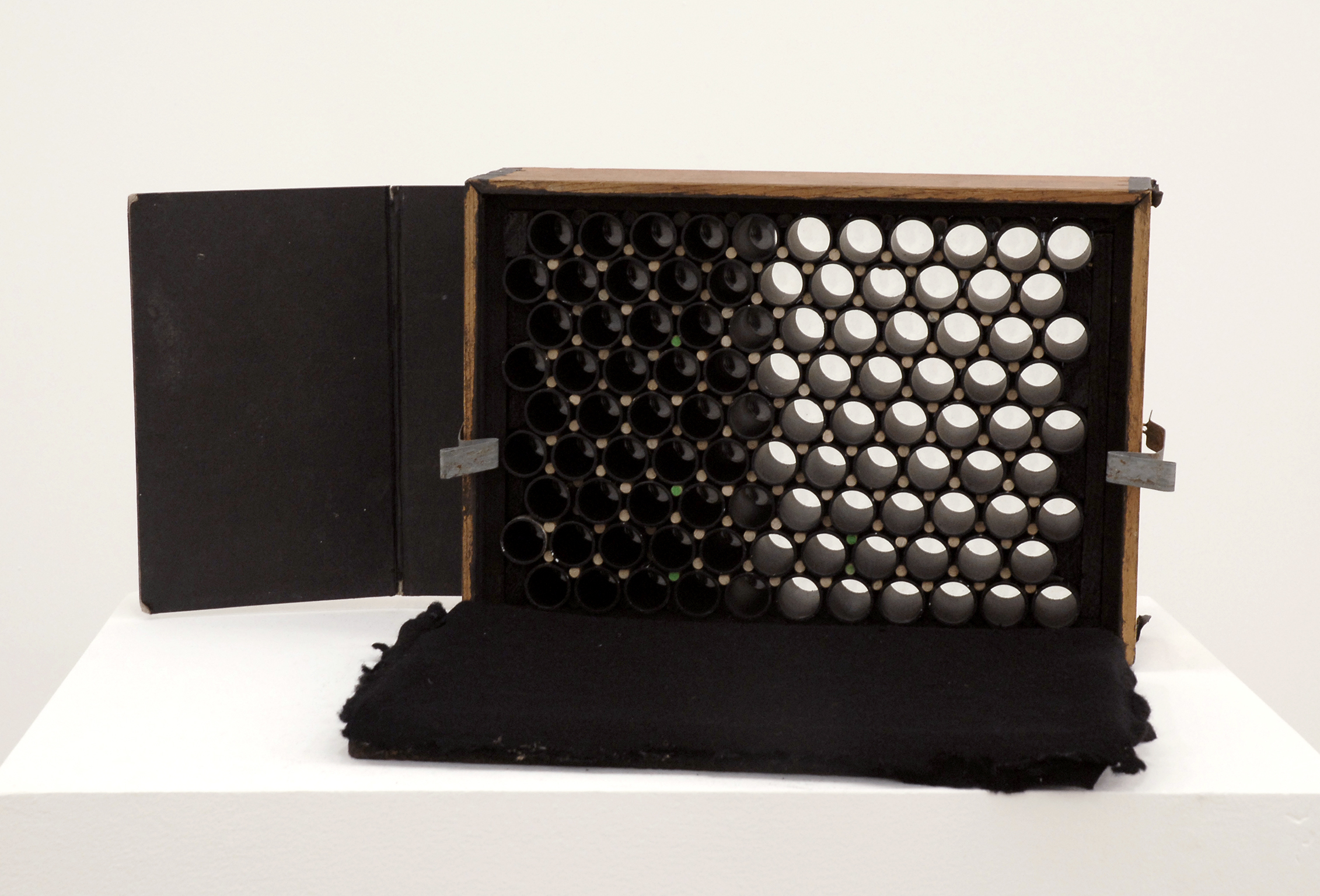 Jerry Pethick, Array Camera, 1988, 99 lenses, wood, felt, game board, glass, plastic pipe, 11 x 15 x 6 in. (27 x 38 x 14 cm) by