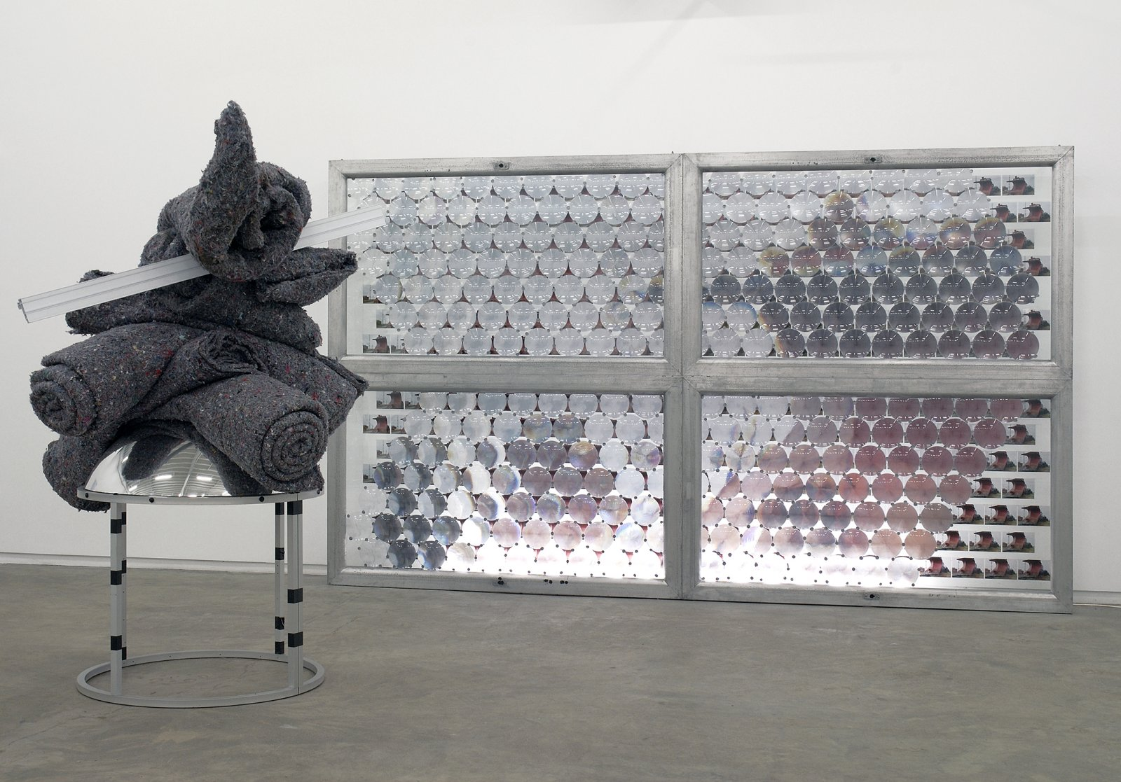 Jerry Pethick, Out of the Corner of an Eye, 1990, 308 photographs, 268 fresnel lenses, aluminum, glass, fluorescent light fixture, carpet underlay, plastic, mirrored dome, black tape, 133 x 144 x 87 in. (338 x 366 x 221 cm)   by Jerry Pethick