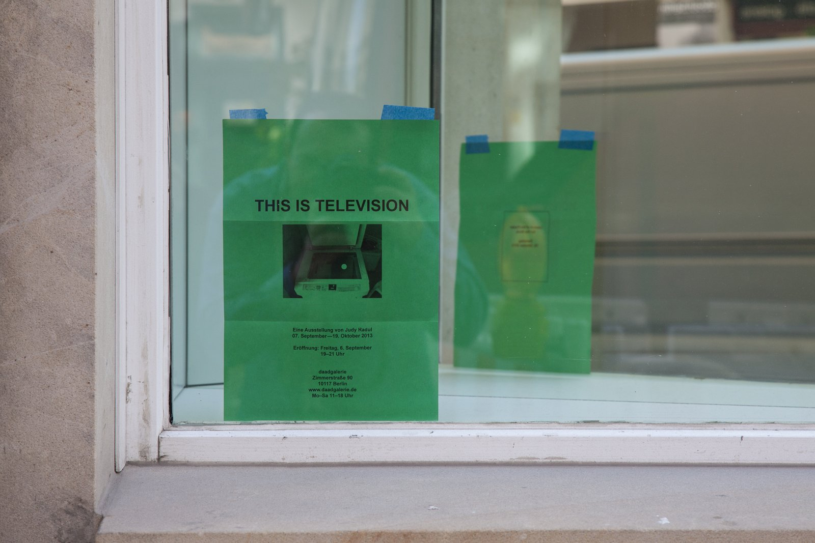 Judy Radul, EXHIBITION INVITATION (detail), 2013, mirror, black and white photocopy on green paper, dimensions variable. Installation view, This is Television, Daadgalerie, Berlin, Germany, 2013 by Judy Radul