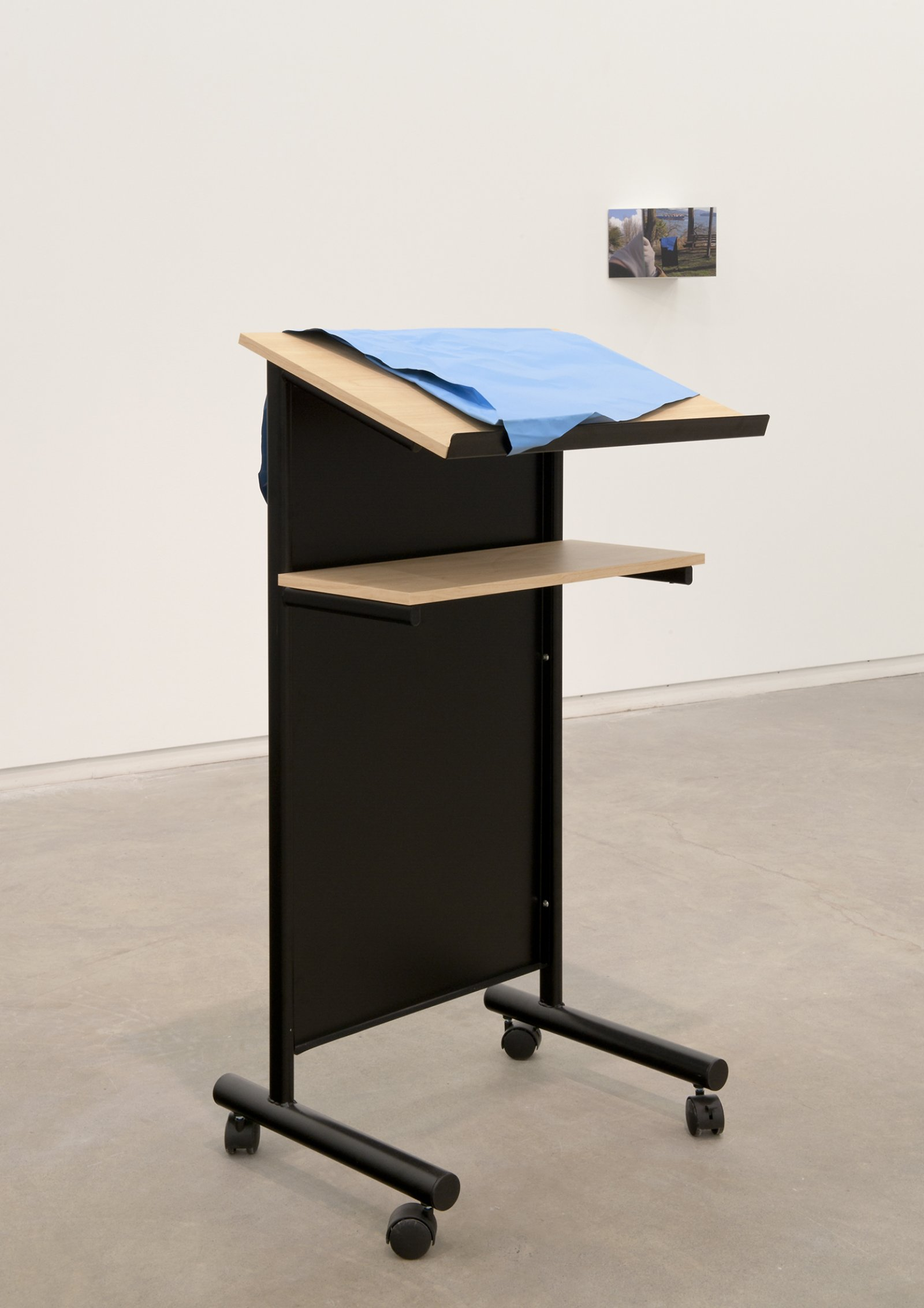 Judy Radul, Object Analysis Spectator Poem (Lectern), 2012, painted copper, lectern, colour photograph, lectern: 47 x 23 x 16 in. (118 x 58 x 39 cm), photo: 8 x 10 x 7 in. (20 x 25 x 18 cm)   by Judy Radul