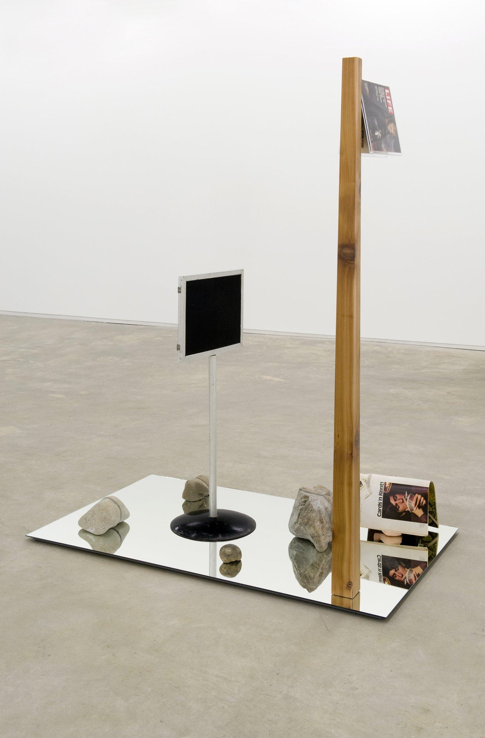 Judy Radul, The Brain Display, 2010, mirror, wood, 5 stones, plastic book holder, Life magazines, doll, 67 x 40 x 80 in. (170 x 102 x 203 cm) by Judy Radul