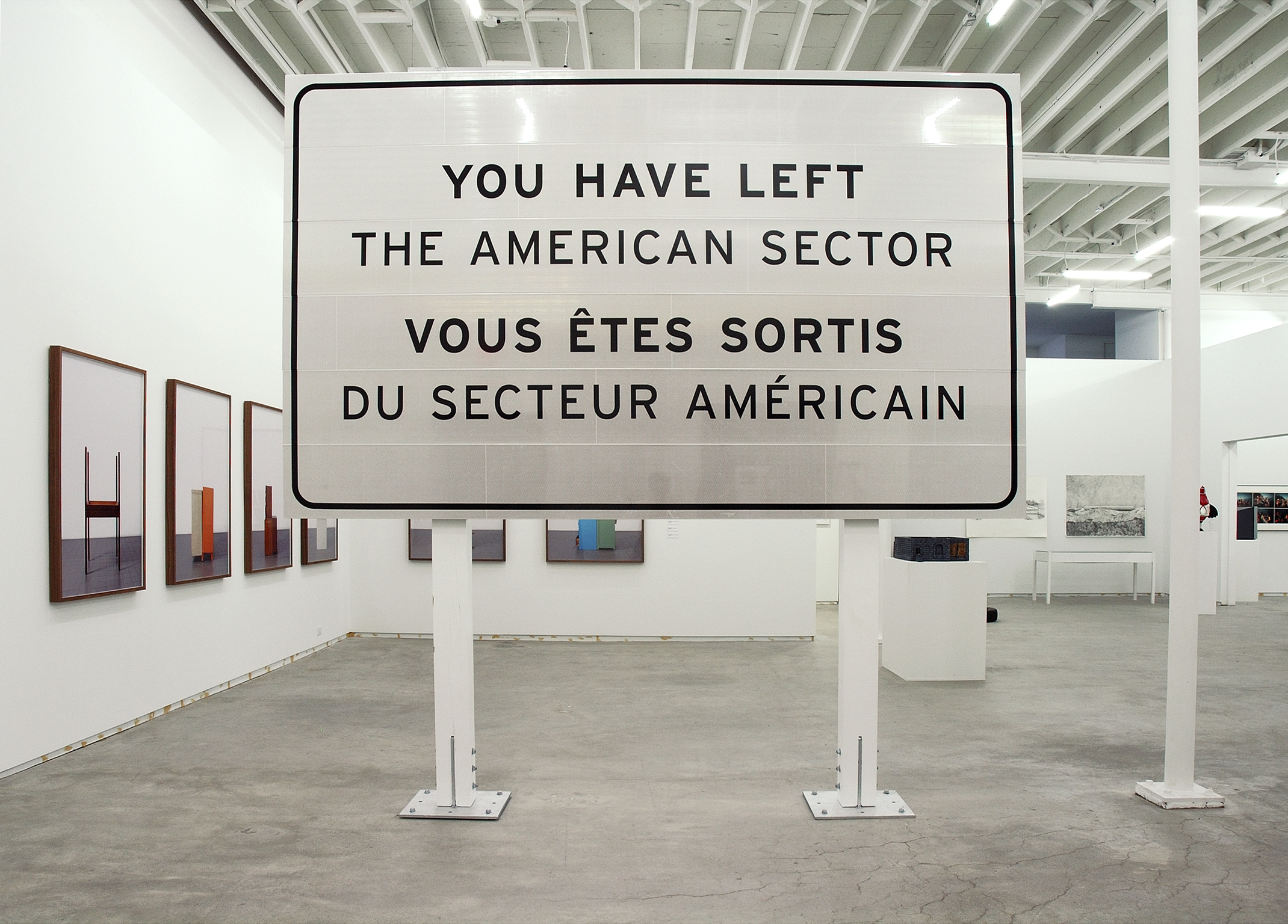 ​Ron Terada, You Have Left the American Sector, 2005, 3m reflective highway vinyl, extruded aluminum, galvanized steel, wood, 120 x 120 x 16 in. (305 x 305 x 41 cm) by