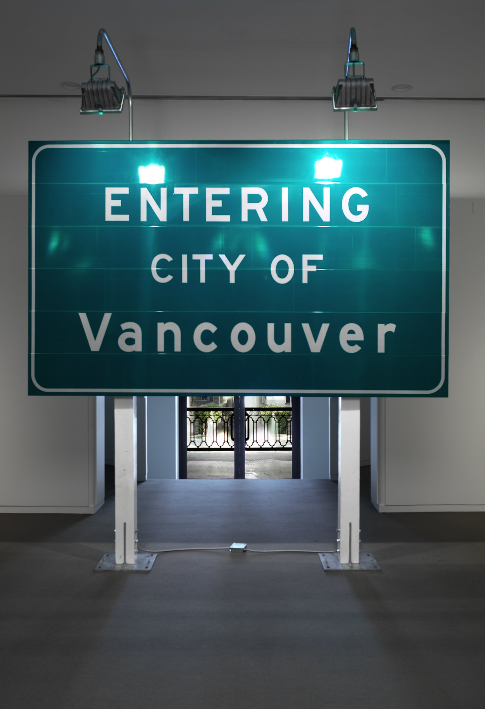 Ron Terada, Entering City of Vancouver, 2002, 3m reflective highway vinyl, extruded aluminum, industrial lights, galvanized steel, wood, 120 x 120 x 60 in. (305 x 305 x 152 cm)