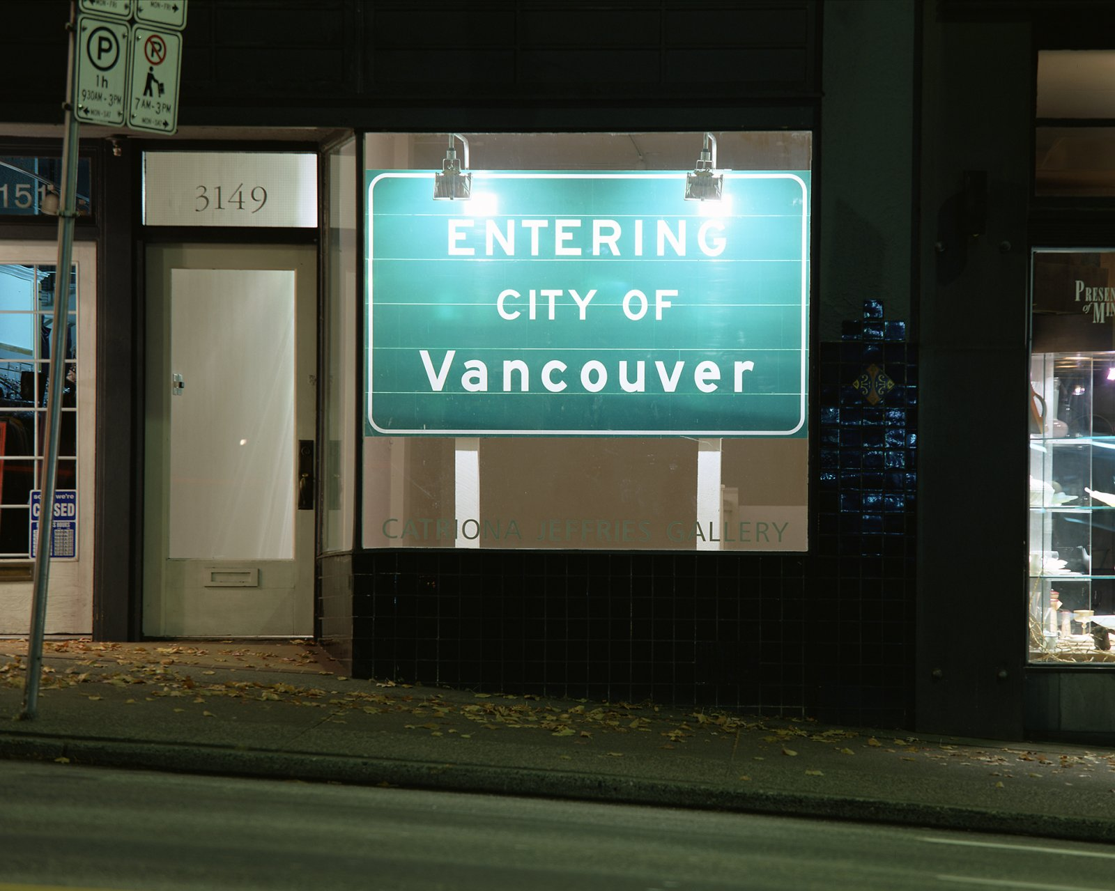 Ron Terada, Entering City of Vancouver, 2002, 3m reflective highway vinyl, extruded aluminum, industrial lights, galvanized steel, wood