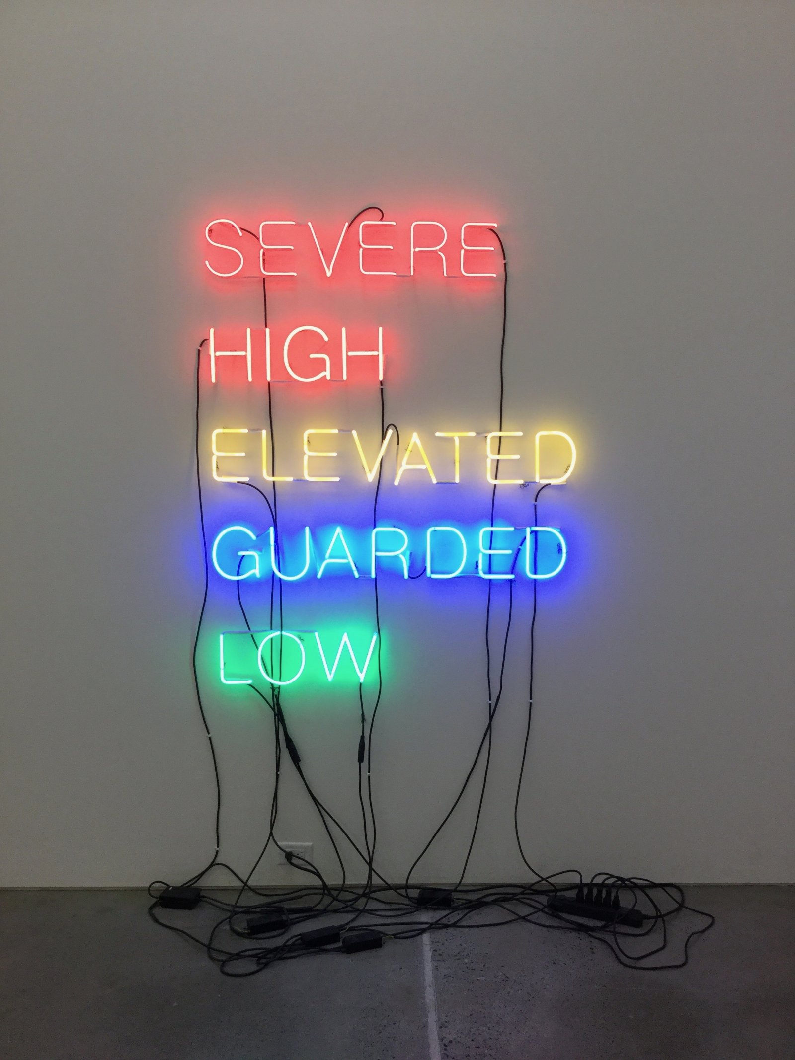 Ron Terada, Five Words in Coloured Neon, 2003, red, orange, yellow, blue and green neon, 67 x 50 x 3 in. (170 x 127 x 8 cm)