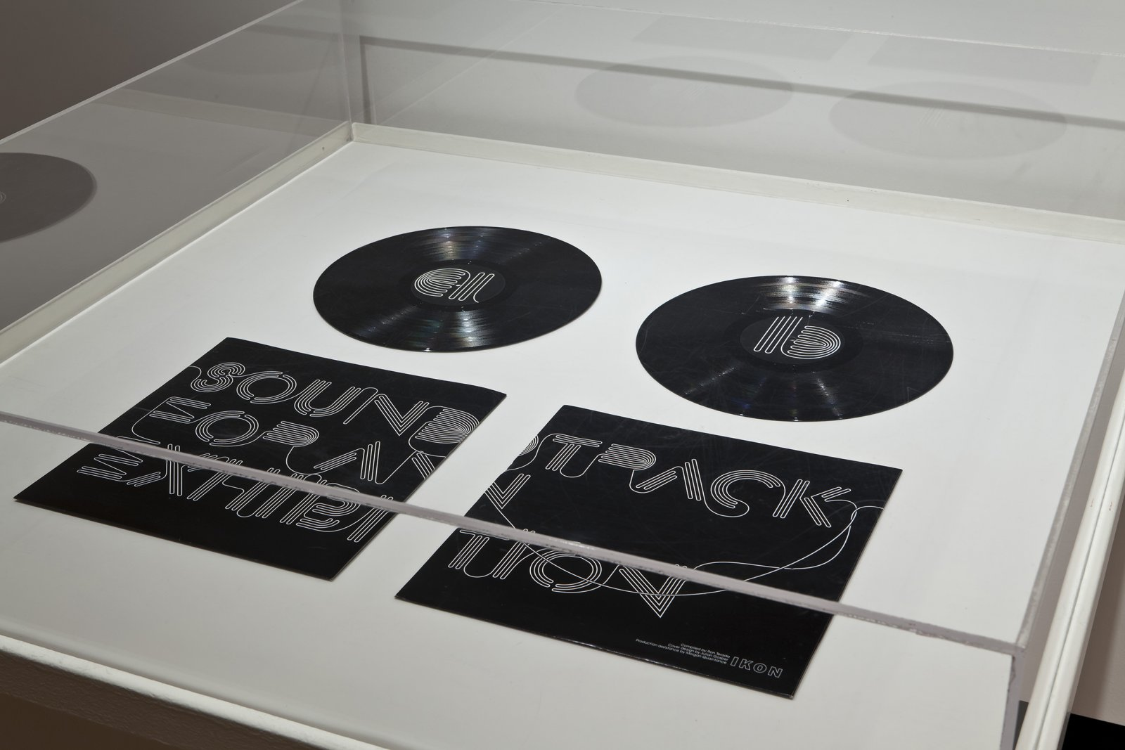 Ron Terada, Soundtrack for an Exhibition, 2010, vinyl record, 12 x 10 in. (30 x 25 cm). Installation view, Who I Think I Am, Justina M. Barnicke Gallery, 2011