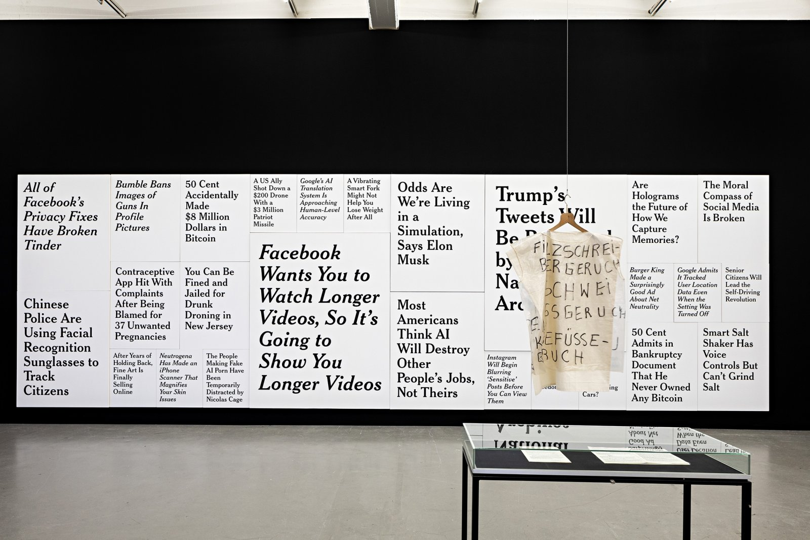 Ron Terada, TL; DR 1, 2017–2018, 26 paintings, acrylic on canvas, 120 x 384 in. (305 x 975 cm). Installation view, Political Affairs: Language Is Not Innocent, Kunstverein in Hamburg, Hamburg, Germany, 2019