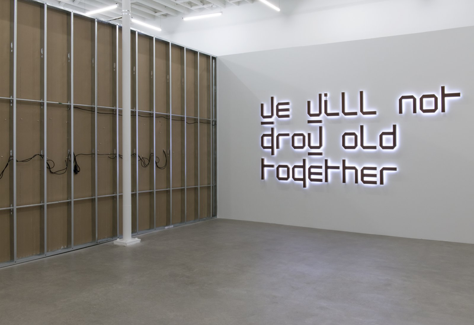 Ron Terada,We Will Not Grow Old Together, 2014, white neon, rusted corten steel, birch plywood, 61 x 136 x 3 in. (155 x 345 x 8 cm)