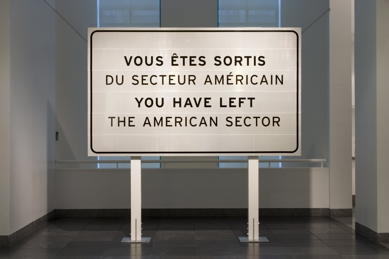 Ron Terada,You Have Left the American Sector, 2005, 3m reflective highway vinyl, extruded aluminum, galvanized steel, wood, 120 x 120 x 16 in. (305 x 305 x 41 cm)