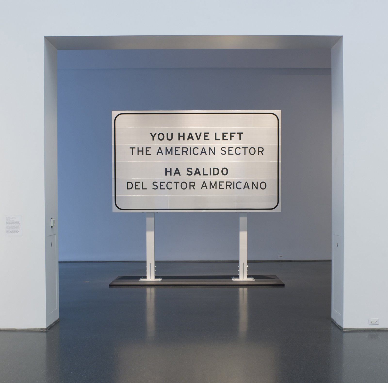 Ron Terada, You Have Left the American Sector, 2005/2011, 3m reflective highway vinyl, extruded aluminum, galvanized steel, wood, 120 x 120 x 16 in. (305 x 305 x 41 cm). Installation view, Being There, MCA Chicago, Chicago, USA, 2011
