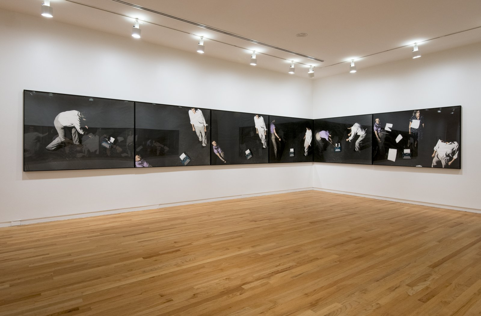 Ian Wallace, An Attack on Literature II, 1975, 12 hand-coloured silver gelatin prints, 49 x 412 in. (124 x 1047 cm). Installation view, A Literature of Images, Vancouver Art Gallery, 2012 by Ian Wallace