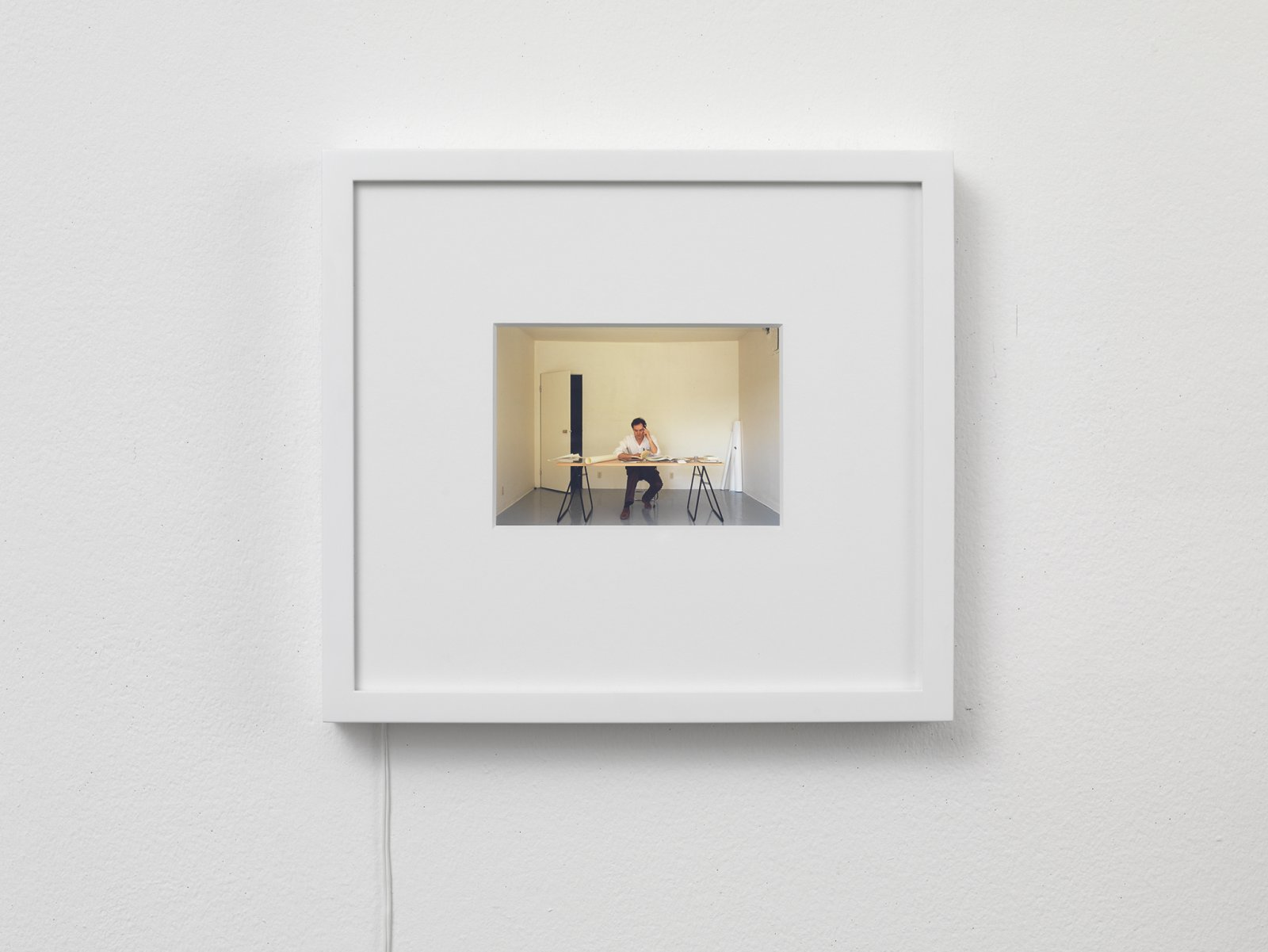 ​​​​​Ian Wallace, ​At Work 1983, 1983, backlit transparency, 15 x 13 in. (37 x 34 cm). Installation view, ​A Literature of Images​, Witte de With, Rotterdam, 2008​​​​​​​​​​ by Ian Wallace