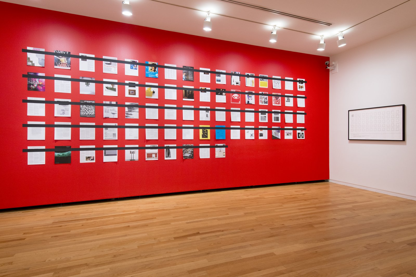 Ian Wallace, Magazine Piece, 2012, magazine pages, tape, painted wall, 108 x 232 in. (274 x 589 cm). Installation view, A Literature of Images, Vancouver Art Gallery, 2012 by Ian Wallace