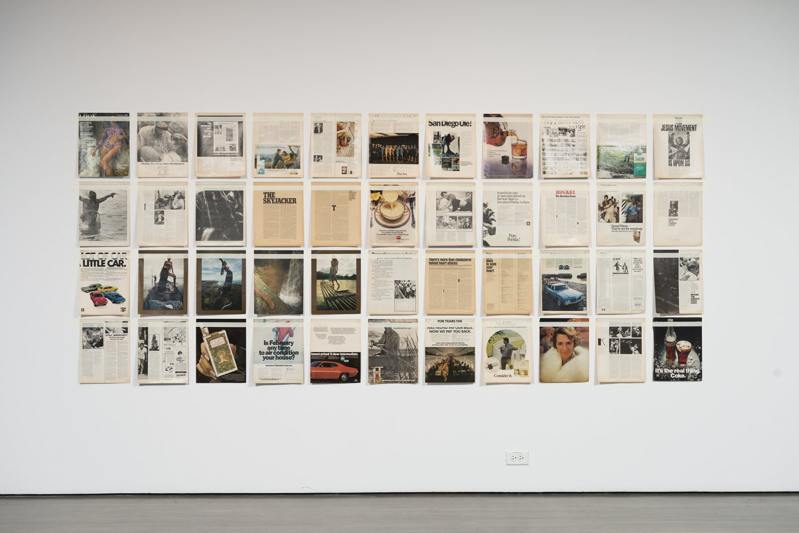 Ian Wallace, Magazine Piece, 1970–ongoing, magazine pages, tape, dimensions variable. Installation view, Qui parle? / Who Speaks?, Leonard and Bina Ellen Art Gallery, Montreal, 2018
