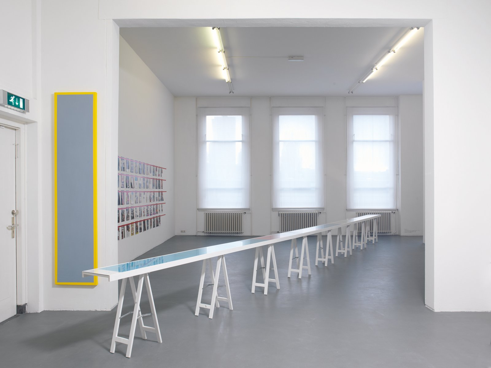 ​​Ian Wallace, ​Untitled (Grey Monochrome with Yellow), 1967–2008, acrylic on canvas, 90 x 20 in. (228 x 50 cm). Installation view, ​A Literature of Images​, Witte de With, Rotterdam, 2008​​​ by Ian Wallace