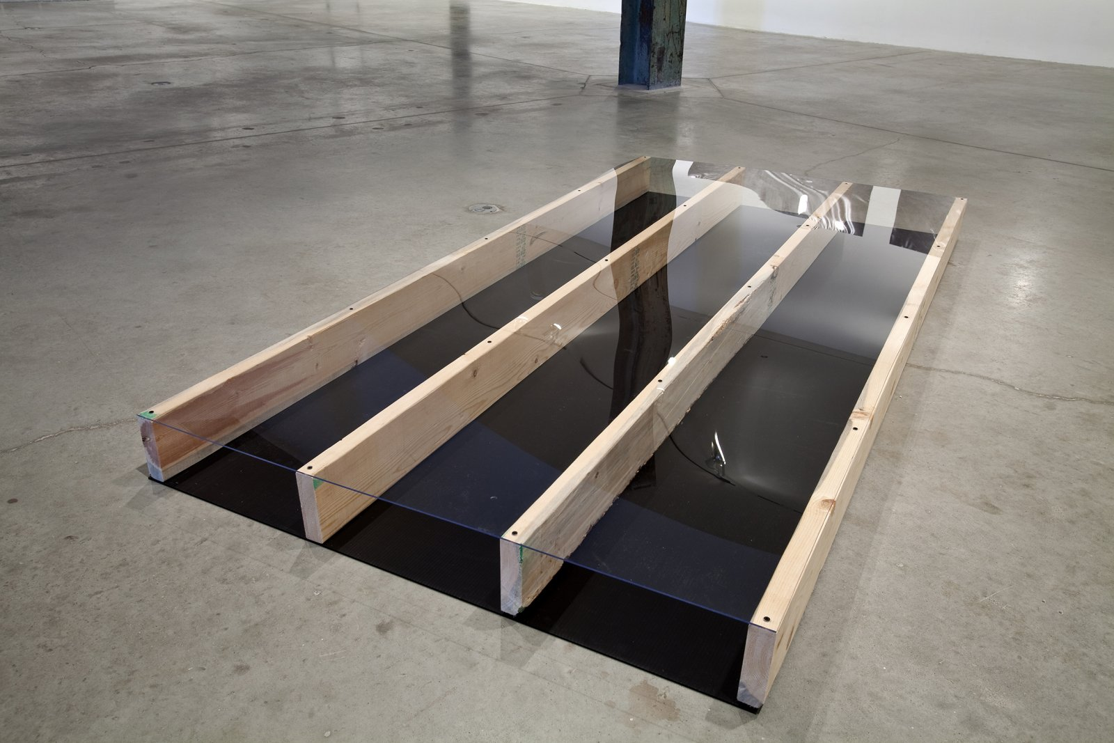 Ian Wallace, Untitled (Plank Piece), 1968, wood, vinyl, dimensions variable. Installation view, The Economy of the Image, The Power Plant, Toronto, 2010 by Ian Wallace