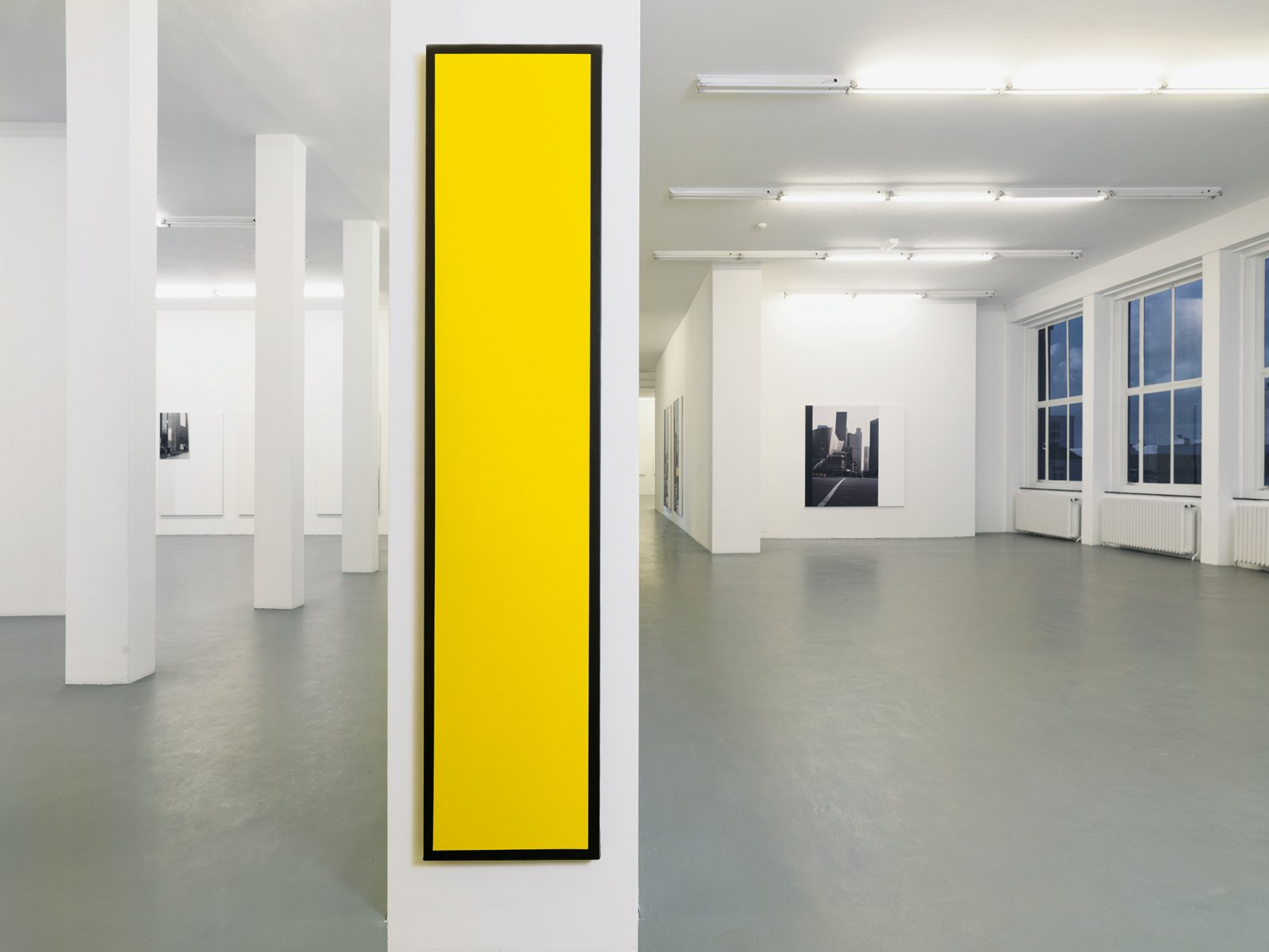 ​​​Ian Wallace, ​Untitled (Yellow Monochrome with Black), 1967–2008, acrylic on canvas, 90 x 20 in. (228 x 50 cm). Installation view, ​A Literature of Images​, Witte de With, Rotterdam, 2008​​​​ by Ian Wallace