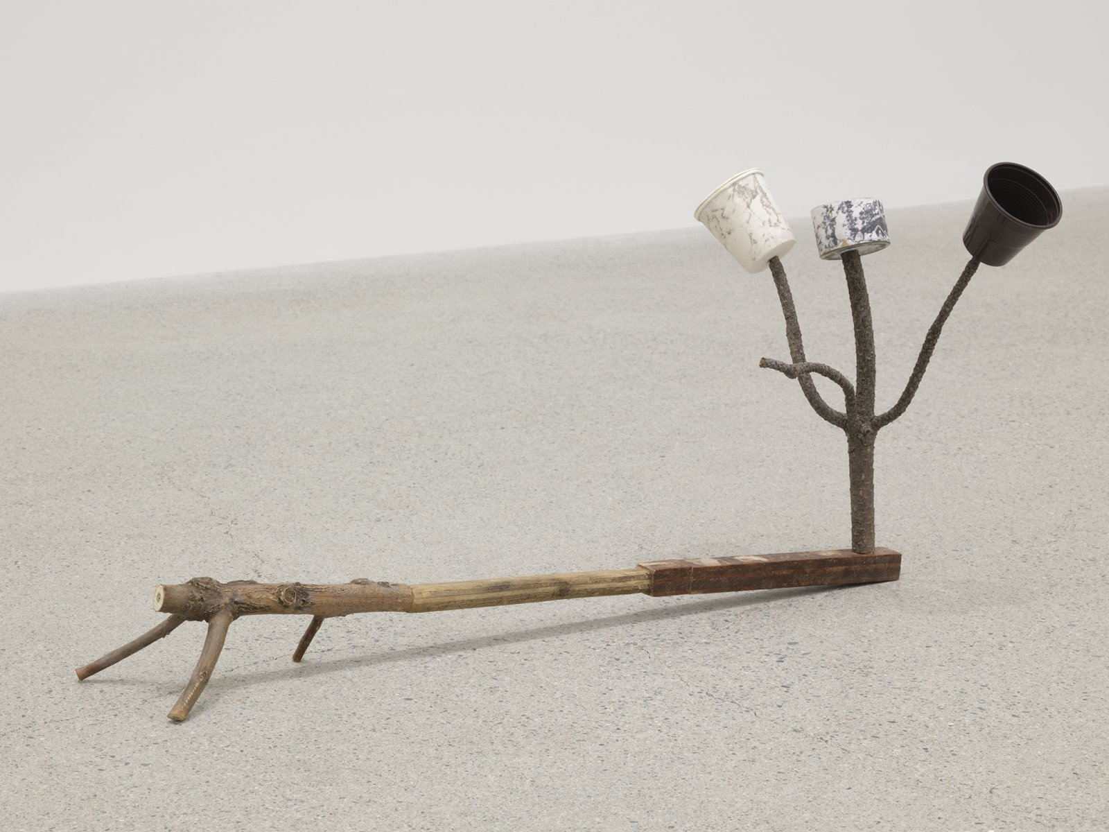 Ashes Withyman, Formula describing a soul rumbling off through the sky after leaving the body, 2019, found branches, plywood with paint, plastic espresso cup, paper cup, lid, cardboard, push pin, 12 x 25 x 10 in. (31 x 64 x 25 cm) by Ashes Withyman